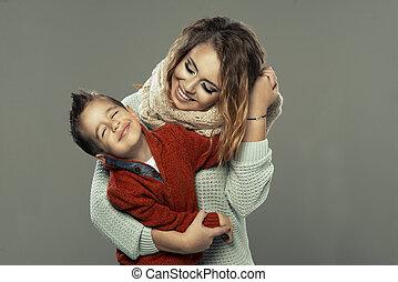 verticaal, van, een, jonge vrouw , met, haar, zoon