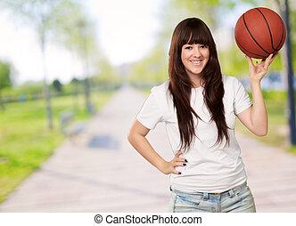 verticaal, van, een, jonge, vrouwlijk, met, een, voetbal, voetbal