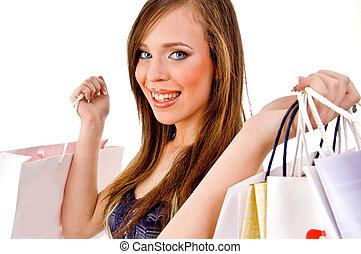 verticaal, van, glimlachende vrouw, vasthouden, zakken