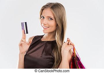 verticaal, van, jonge, mooi, glimlachende vrouw, met, krediet, card., brunette, meisje, en, velen, kleurrijke, het winkelen zakken, vrijstaand, op wit, achtergrond