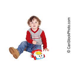 verticaal, van, jongetje, met, zijn, speelbal, telefoon.