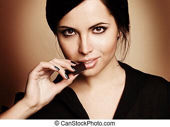 verticaal, van, mooie vrouw, met, een, chocolade