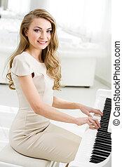 verticaal, van, pianist, zittende , en, spelende piano