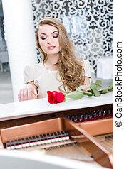 verticaal, van, vrouw, met, claret, roos, spelende piano