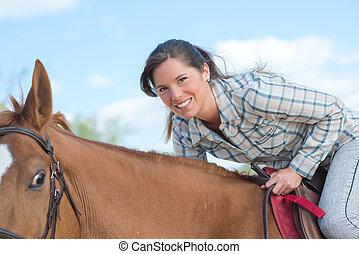 verticaal, van, vrouw, op, horseback