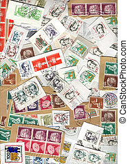 Vertical background of German postage stamps
