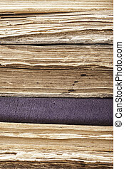vertical background stack of old books closeup
