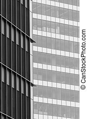 Vertical background with building windows. Close up architecture abstracts from office buildings in downtown.