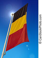 Vertical Belgium Flag - waving in the blue sky