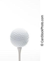 Vertical close up of a golf ball on a tee