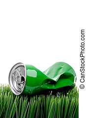 vertical close up of a green crushed aluminum drink can on grass