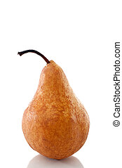 Vertical close up of a pear on a white reflective surface
