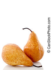 Vertical close up of two pears on a white reflective surface