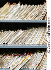 Vertical composition of 3 layers of medical record files....