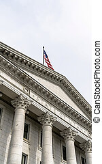 Vertical crop Pedimented entrance of historic Utah State Capital building in Salt Lake City