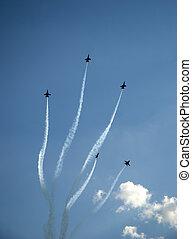 Navy Blue Angel aircraft performing the vertical disburse maneuver.