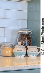 Vertical frame Glass storage jars with coffee and sugar