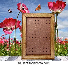 Vertical frame on wooden floor over spring meadow