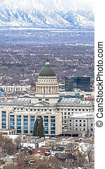 Vertical frame Utah State Capitol Building against a sweeping view of Salt Lake City in winter