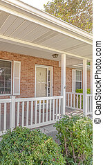 Vertical Front porch and garden of traditional brick home