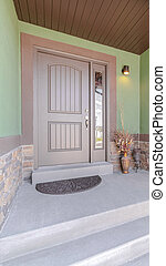 Vertical Front porch step and door of traditional home