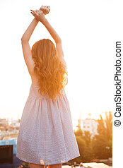 Vertical image of a ginger woman posing back