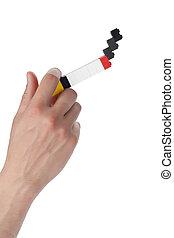 a hand smoking a lego cigarette