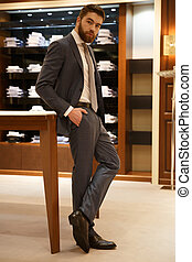 Vertical image of man posing in shop