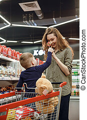 Vertical image of mother and son with candys - Vertical...