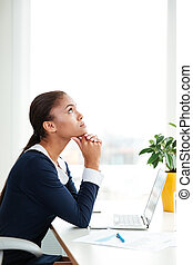 Vertical image of pensive african business woman in dress