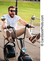 Vertical image of scared screaming bearded man in sunglasses