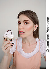 Vertical image of woman holding cake
