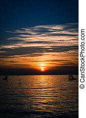 vertical orange scenic sunset over sea horizon
