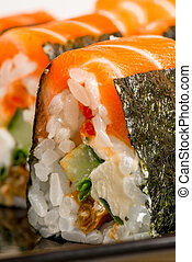 Vertical Photo - delicious rolls with salmon close-up