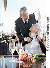 Vertical photo of delighted couple that enjoying the moment