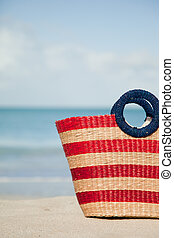 vertical picture of striped beach bag