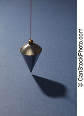 Vertical plumb on blue background
