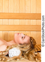 vertical portrait face close-up - beautiful girl relaxing in a sauna
