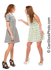 Vertical portrait of a arguing girls on a white background