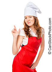 Vertical portrait of a beautiful girl in an apron and chef cap