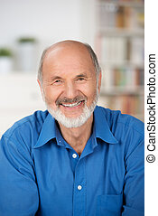 Caucasian cheerful bearded senior man smiling