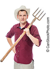 Vertical portrait of a farmer on a white background with a pitchfork