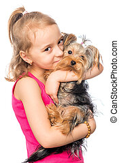 Vertical portrait of a girl with a pet terrier on a white background
