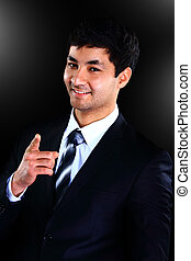 Vertical portrait of a happy young businessman over a black background