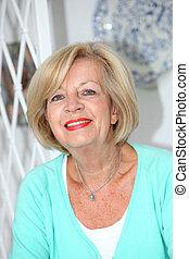 Vertical portrait of a senior woman smiling