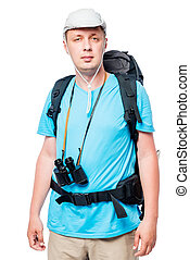 Vertical portrait of a tourist man with a backpack on a white background