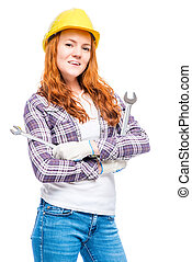 vertical portrait of a woman in a helmet with mechanic keys...