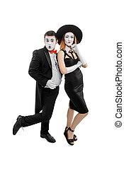 Vertical portrait of two mimes. Man and woman as mime artists