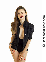 vertical portrait pretty smiling girl in a black suit is...