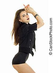 vertical protrait of beautiful brunette woman in black...